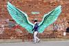 On the wings of love Liverpool (James- Burke) Tags: liverpool balticquarter candid man mobilephone murals phone street streetphotography walker wallart wings artwork paulcurtis jamaicastreet