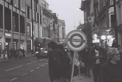 Ilford Delta 3200 test roll shot at 1600 (danielchapman1) Tags: london centrallondon tottenhamcourtroad busstop sign people street monochrome blackandwhite ilforddelta3200 delta3200