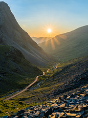 Honister Pass Sunset (thomasgreen92) Tags: sun sunset england photography photo landscape sea light lighthouse sony tripod manfrotto lens camera picture image grass colour rocks ocean water sky bay rock nikon d750 1835 dawn sunrise lone tree lonetree lakedistrict beautiful beauty reflections reflection lake mountain wood serene sunstar sunlight honister pass