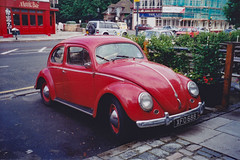 Flashbacks to 1997: VW Beetle (Can Pac Swire) Tags: england great britain uk unitedkingdom british scan scanned old classic vintage bug vw beetle red car auto automobile 1997img0019 number plate licence license xfo688 musicbar liongate hotel surrey eastmolesey