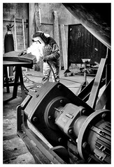 Welcome to the newest chapter in the history of iron (MarcoBertarelli) Tags: welder weld iron contrast monochrome monochromatic bw industry industrial
