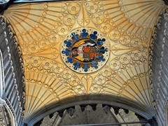 Ribbed ceiling with carved angel and coat-of-arms boss - Winchester Cathedral, Hampshire, England. (edk7) Tags: olympuspenliteepl5 edk7 2016 uk england hampshire hants winchester cathedralchurchoftheholytrinity winchestercathedral churchofengland church gradeilisted englishperpendiculargothicc1400 monument architecture building oldstructure arch rib vault sculpture stonecarving ceilingboss retrochoir cardinalbeaufortchantrychapel c1445 angel coatofarms armourialshield medieval tomb