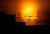 Antenna and the Sun (BP Chua) Tags: sun sunset antenna silhouette orange nikon 600mm 10stops singapore housingestate hdb asia
