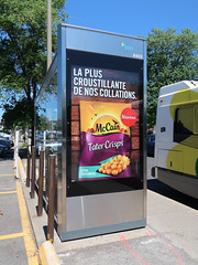 Munchin on taters at bus stops in France. (Tim Kiser) Tags: 2018 20180603 avenuevanhorne canada côtedesneiges côtedesneigesneighborhood côtedesneiges–notredamedegrâce frenchlanguage frenchlanguageadvertisement img2808 islandofmontréal june june2018 mccain mccainfoods montréal montréalcanada montréalquébec montréalquébeccanada montréalbusstop québec ruelemieux stm stmbusstop sociétédetransportdemontréal urbanagglomerationofmontréal vanhorneavenue vanhorneandlemieux ad advertisement birdsinart bollards brandname bus busshelter busshelteradvertisement busstop busstopshelter busstopshelteradvertisement cloudlesssky collations crispiness crisps crispy croquantes croustillante extracrunchy flyingbirds foodbrand foodpackaging friedpotatosnacks friedpotatoes frozenfood frozenfoodpackaging frozenpotatosnacks frozenpotatoes lapluscroustillantedenoscollations newproduct nouveau packaging parkingspaces potatosnacks southquébec southernquébec southwestquébec southwesternquébec sunny sunrise sunriseinart tater tatercrisps taters îledemontréal txtchg