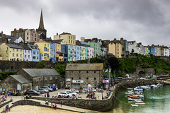 Paint the town...every colour imaginable (The Frustrated Photog (Anthony) ADPphotography) Tags: architecture boat category citiestowns external harbourbeach pembrokeshire places tenby tenbyharbour transport travel wales seafront cliff harbour church churchspire houses buildings structures victorian sea colours colorful town colourful sky greyclouds greyskies uk unitedkingdom greatbritain outdoor travelphotography skyline water people building