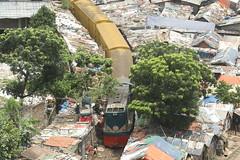A train passes through a slum (Sudeepto Salam) Tags: train dhaka slum chaos rail