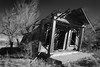 leaning (Tomás Harrison Fotos) Tags: d750 usa ghosttown ngc torrancecounty abandoned encino landscape nikonblackandwhite ushwy285 afnikkor24mmf28d availablelight nm dying