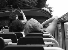tourist. (framingthestreets) Tags: apan tokyo shinjuku shibuya odaiba takadanobaba •canon dslr objective lens blackandwhite streetphotography streetphotographer daidomoriyama streertart reality reallife livingthemoment captured framed tourist hoponhopoff touristattraction bus seats focus blond blonde openair