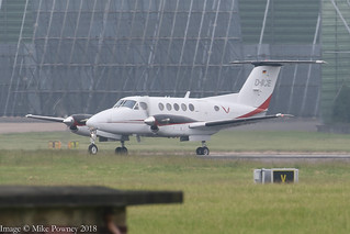 D-IICE - 1977 build Beech B200, crossing Runway 23R at Manchester prior to departing on 23L