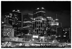 Melbourne Skyline (PEN-F_Fan) Tags: monochrome mirrorless microfourthirds monotone pencamera on1photoraw olympuspenf lights lens filmlook mzuiko12100mmf40pro mft m43 sky silverefexpro raw skyline zoomlens type style photoframe photoedge photoborder postprocessing processingsoftware preset blackandwhite building camera affinityphoto australiaandoceania blackwhite dxophotolab effect filmeffect cityscape colorefexpro dxonikcollection melbourne victoria australia aus skyscraper night architecture city waterfront road water clouds