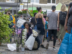 DSC_2664b London Columbia Road Sunday Flower Market Lady with Exotic Orchids (photographer695) Tags: london columbia road sunday flower market lady with exotic orchids