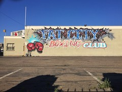 Fat City (misterbigidea) Tags: neighborhood wall painted fightclub downtown sky blue morning club fatcity barrio lifestyle urban city streetview sign gloves lettering art mural building gym boxing