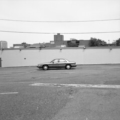 car (kaumpphoto) Tags: rolleiflex 120 tlr bw black white car minneapolis park building wire pavement wall tire wheel hubcap sky auto automobile city urban street powerline isolate isolated alone single one singular parking lot