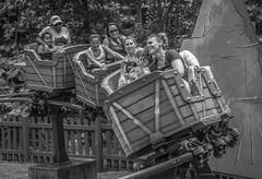Summer Fun on a Coaster (Airborne Guy) Tags: rollercoaster fun laugh smile people summer park amusementpark themepark recreation kids bnw bw blackandwhite monochrome ride
