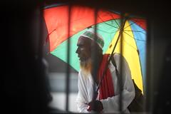 And Ode To The Far Sighted (N A Y E E M) Tags: oldman beggar umbrella colors candid portrait today friday afternoon light fence street pitstop laalkhanbazaar chittagong bangladesh carwindow sooc raw unedited untouched ramadan