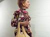 (heatherbirdtx) Tags: stranger gallery art candid stolen color interior availablelight woman purse blouse brick wall portrait