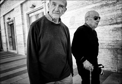 Old Souls (Steve Lundqvist) Tags: teramo italy italia italiano povertà poverty street streetphotography coat shot old poor elderly vecchi monocromo persone man monochrome overcoat candid walking aged age people blackandwhite bw sidewalk marciapiede character personaggio snap art bruce gilden vivian maier world outside leica q