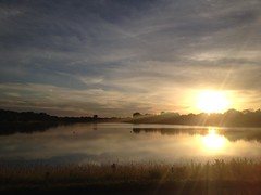 Lake Arlington (dimitrioskapsalis) Tags: usa illinois arlington heights sunset lake water sun cloudy spring blue sky