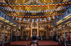 2018 - Romania - Bucharest - The Great Synagogue (Ted's photos - For Me & You) Tags: 2018 bucharest nikon nikond750 nikonfx romania tedmcgrath tedsphotos vignetting thegreatsynagogue bucharestthegreatsynagogue thegreatsynagoguebucharest bucharestromania church churchinterior synagogue seating emptyseats colums flags romanianflag jewishmuseum jewishmuseumbucharest bucharestjewishmuseum unitedholytemple bucharestunitedholytemple unitedholytemplebucharest red redrule synagoguemare bucharestsynagoguemare synagoguemarebucharest