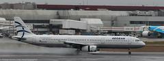 Aegean A-321 landing at LHR (Alaskan Dude) Tags: travel europe england london heathrow londonheathrow lhr airplane airplanes jets airlines airliners aviation planespotting planewatching