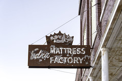 Edna Mattress Factory (unknown quantity) Tags: neglect rust peelingpaint fadedpaint neonsign sky weathered oxidation deterioration fadedsign exposedmetal corrugated