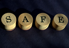 SAFE (Tony Worrall) Tags: geometric abstract pattern texture symmetry minimalism surreal serene depthoffield bright photoborder shapes misc object round feature letters printed wooden tabs safe sure word words letter shadows statement nice
