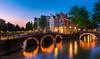City of freedom - The Amsterdam classic (Prajeesh Prathap) Tags: city cityscape amsterdam europe travel freedom bluehour sunset goldenhour photography landscape vacation night nightscape lights canal calmwater longexposure netherlands dutch holland relfections old oldtown medeival nopeople quiet antique vibrant remnants serene serenity architecture beautiful bridge hobby leisure tour romance romantic dinner walking enjoyingsunset