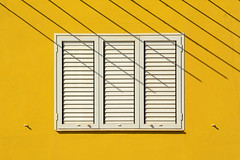 White window, yellow wall and stripes (Jan van der Wolf) Tags: map18260vvve fuerteventura stripes strepen shadow shadowplay schaduw schaduwspel window raam blinde shutter yellow geel white wit gevel facade