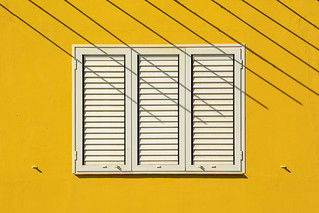 White window, yellow wall and stripes