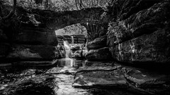Beck and Bridge (Black Dog Photography Melbourne) Tags: beck stream bw yourkshire dales waterfall bridge rocks swaledale cliff scar house force