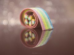 Sugar Rainbow (Carla Mountain Spirit) Tags: gum heart reflections dof bokeh multicolor macrodreams macromondays candy sony gummy sweetmelodies macromagic carlafreire sugar