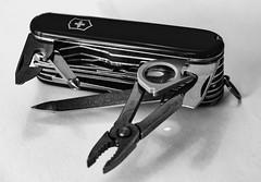 Well worn Swiss Army Knife -- HMM! -- EXPLORED (Thad Zajdowicz) Tags: ef100mm f28l macro is usm macromondays handtools zajdowicz pasadena california primelens canon eos 5dmarkiii 5d3 dslr digital availablelight lightroom 100mm monochrome blackandwhite bw black white light shadow tools knife swissarmyknife pliers magifyingglass bottleopener canopener screwdriver file handtool