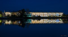 The Olympic Oval On The River (Clayton Perry Photoworks) Tags: vancouver bc canada richmond night lights explorebc explorecanada reflections fraserriver skyline richmondolympicoval