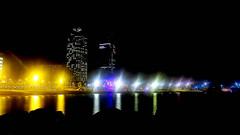 A double coffee on the rocks, please. (Fnikos) Tags: sea beach sand shore seashore rock water waterfront night light reflection nightview city building tower sky skyline skyscraper architecture colour outdoor