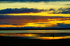 watching the sun set (prajpix) Tags: people silhouette reflection sea water hills sunset findhorn kinloss moray firth scotland sky clouds