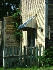 Old Town (jHc__johart) Tags: fence trumpetflower vine wall house awning oklahoma building window