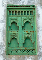 Wooden carved window of an abandoned house, Dhofar Governorate, Mirbat, Oman (Eric Lafforgue) Tags: abandoned arabia arabianpeninsula arabic arabicarchitecture arabicstyle architecture buildingexterior carved carvedwindow carvingcraftproduct colorimage day decrepit dhofar dhufar exteriorview facade ghosttown green gulfcountries habitation history house houseexterior mirbat moscha nopeople old oldhouse oman oman18201 outdoors sultanate thepast traveldestination traveldestinations vertical weathered window woodenwindow dhofargovernorate om