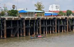 Small boat - big bridge - on the Mighty Mekong. (One more shot Rog) Tags: rivers river mekong mekongriver cambodia vietnam nam boats boat riverpeople boatpeople asia riverlife livingonaboat floatingvillages
