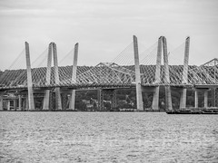 Governor Mario M. Cuomo Bridge and original Tappan Zee Crossing (being dismantled) on the Hudson River, Tarrytown, New York (jag9889) Tags: 1955 2018 20180606 bw barge blackandwhite bridge bridges bruecke brücke cablestayed cantilever construction crossing dismantling governormalcolmwilsontappanzeebridge hudsonriver infrastructure k004 k893 mariomcuomobridge monochrome ny newnybridge newyork newyorkthruway orangetown original outdoor pont ponte puente punt river rocklandcounty section southnyack span structure tappanzee tappanzeebridge tappanzeebridgereplacement tarrytown thenewnybridge twinspan usa unitedstates unitedstatesofamerica water waterway westchestercounty jag9889