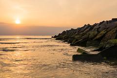 Set In Stones (Alex Fonderson) Tags: sunset beach netherlands holland nederland scheveningen breakwater sea