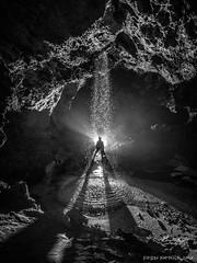La cascade de la galerie des Graviers (Fern nebula) Tags: speleology spéléologie cavers caving cave alpesmaritimes calern flash olympus yongnuo paca cascade monochrome contrejour