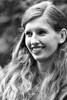 Portrait of a Young Woman (d_t_vos) Tags: woman youngwoman observer spectator hair curlyhair face smile teen teenager teeth dof contrast lokaalvocaal festival leeuwarden prinsentuin groeneweg streetphotography streetportrait outsidde pearl earring ear dickvos dtvos