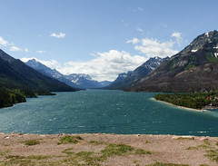 A favourite view, Waterton Lakes National Park (annkelliott) Tags: alberta canada southernalberta nearcanadausborder watertonlakesnationalpark sofcalgary calgarytowaterton264km159miles drivingtimeroughly3hrs upperwatertonlake seenfromprinceofwaleshotel nature scenery landscape view scenic mountains peaks mountainside mountainslope lake water trees forest town building recreation clouds sky outdoor spring 12june2018 fz200 fz2004 annkelliott anneelliott ©anneelliott2018 ©allrightsreserved