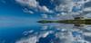 On reflection (paullangton) Tags: reflection beach sky sea blue clouds headland cornwall fistral hotel sand coast canon 7dmk2 mirror horizon seascape