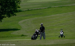 Golfing Slopes (M C Smith) Tags: golf man walking clubs trolley bag pentax k3ii green fairway grass trollies ditch weeds shadows trees slopes