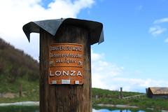 Mex (bulbocode909) Tags: valais suisse mex poteaux panneaux montagnes nature printemps nuages bleu vert orange