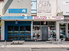 Ballarat 015 (Peter.Bartlett) Tags: chair eating fastfood shopfront australia facade doorway vsco colour victoria hat urban girl sitting streetphotography people m43 microfourthirds shopwindow cafe peterbartlett sign olympuspenf kodakportra160emulation city ballaratcentral au