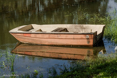 Lonely.. (stubalac) Tags: ship boat reflection river sun water danube sky