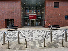 sloe (Harry Halibut) Tags: 2018©andrewpettigrew allrightsreserved imagesofsheffield images sheffieldarchitecture sheffieldbuildings colourbysoftwarelaziness sheffield south yorkshire sheff1805268422 hallam university shu institute education red brick cycle racks stainless steel curvy stone seats entrance revolving door charles street faculty development society city campus sioe