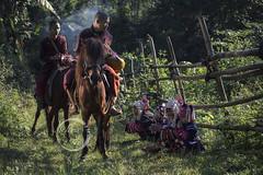 Monks on horses